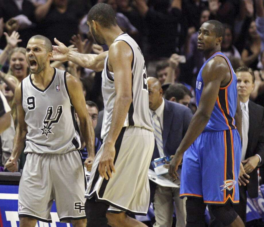 San Antonio Spurs' Tony Parker celebrates with teammate Tim Duncan after making a two point basket at the end of the game as Oklahoma City Thunder's Serge Ibaka looks on Thursday Nov. 1, 2012 at the AT&T Center. The Spurs won 86-84. (Edward A. Ornelas / San Antonio Express-News)
