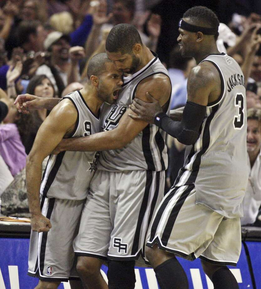 San Antonio Spurs' Tony Parker (from left) is congratulated by teammates Tim Duncan and Stephen Jackson after making a two-point basket to win the game against the Oklahoma City Thunder during second half action Thursday Nov. 1, 2012 at the AT&T Center. The Spurs won 86-84. Read more
