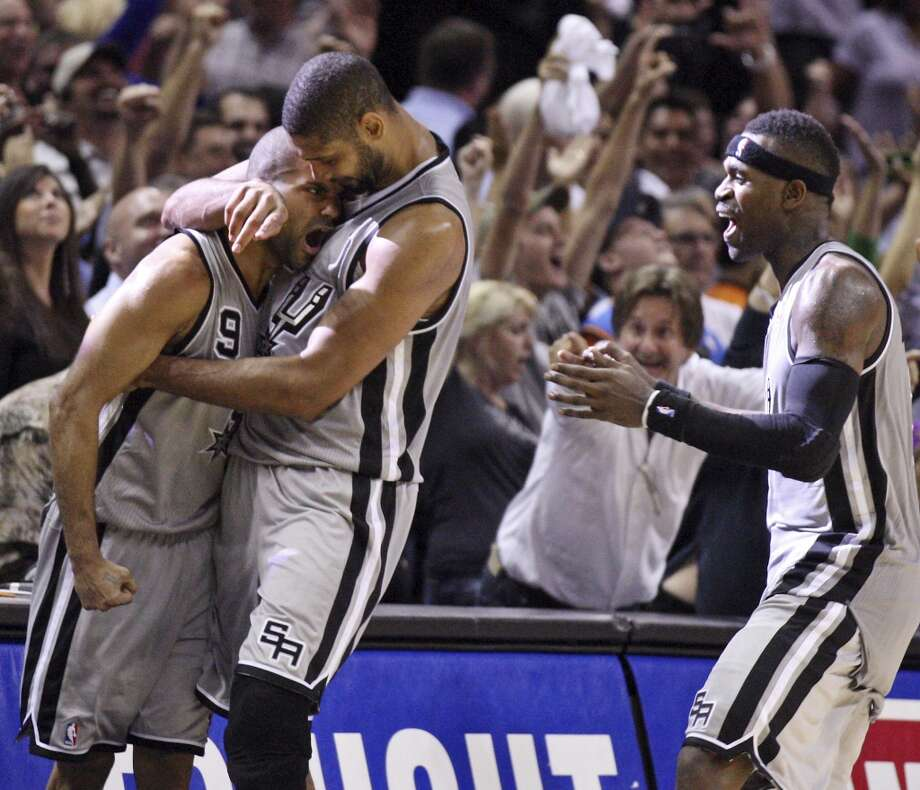 San Antonio Spurs' Tony Parker (from left) is congratulated by teammates Tim Duncan and Stephen Jackson after making a two point basket to win the game against the Oklahoma City Thunder during second half action Thursday Nov. 1, 2012 at the AT&T Center. The Spurs won 86-84. (Edward A. Ornelas / San Antonio Express-News)