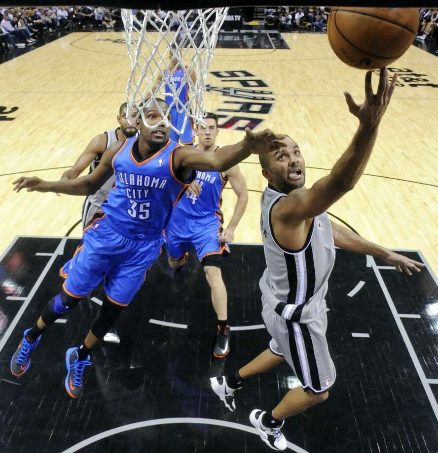 San Antonio Spurs' Tony Parker shoots around Oklahoma City Thunder's Kevin Durant during second half action Thursday Nov. 1, 2012 at the AT&T Center. The Spurs won 86-84. (Edward A. Ornelas / San Antonio Express-News)