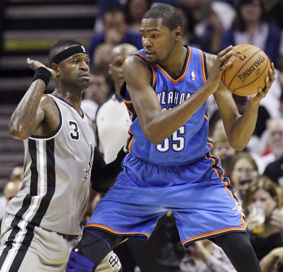 Oklahoma City Thunder's Kevin Durant looks for room around San Antonio Spurs' Stephen Jackson during first half action Thursday Nov. 1, 2012 at the AT&T Center. (Edward A. Ornelas / San Antonio Express-News)