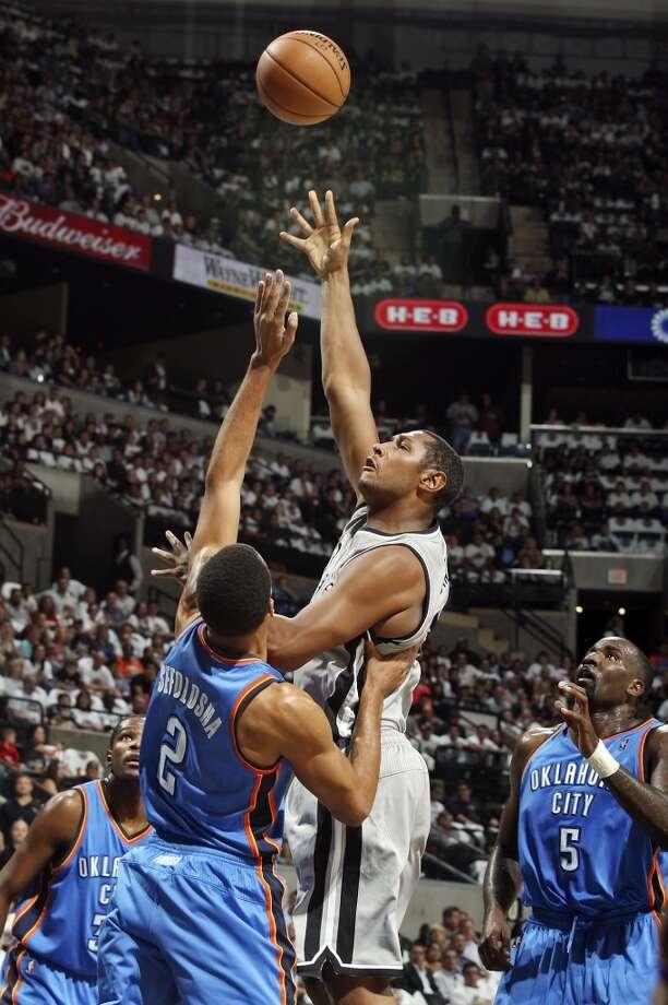 San Antonio Spurs' Boris Diaw shoots over Oklahoma City Thunder's Thabo Sefolosha during first half action Thursday Nov. 1, 2012 at the AT&T Center. (Edward A. Ornelas / San Antonio Express-News)