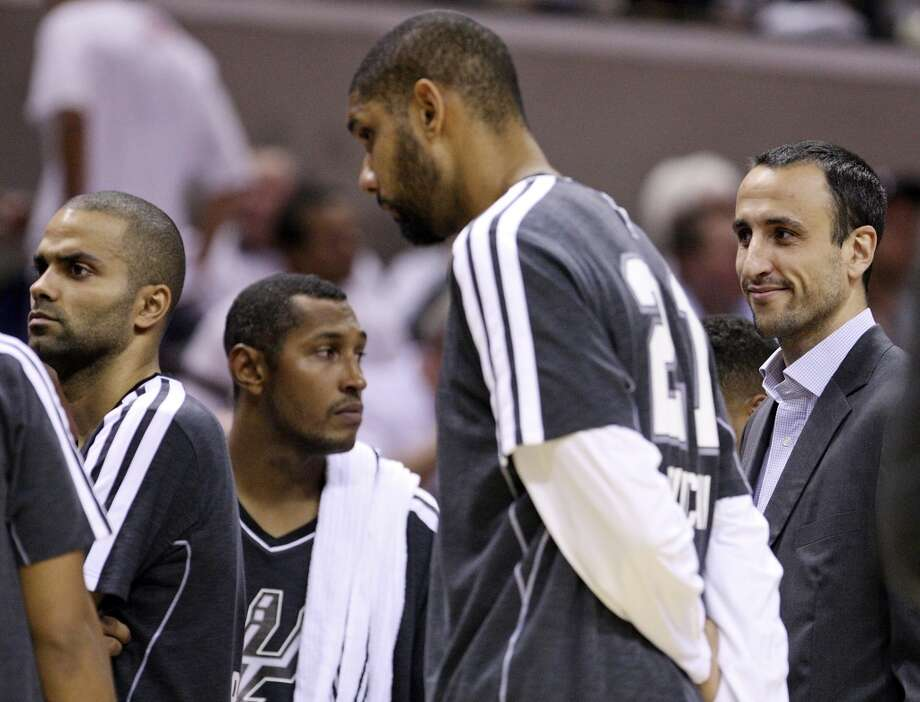 San Antonio Spurs' Manu Ginobili (right) huddles with the team during a timeout against the Oklahoma City Thunder during first half action Thursday Nov. 1, 2012 at the AT&T Center. (Edward A. Ornelas / San Antonio Express-News)