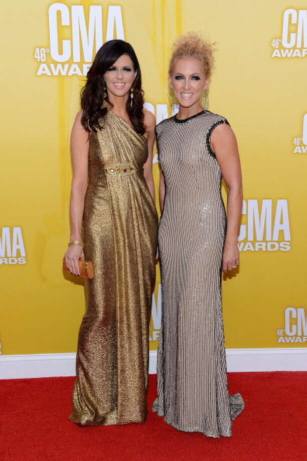 Karen Fairchild and Kimberly Schlapman attend the 46th annual CMA Awards at the Bridgestone Arena on November 1, 2012 in Nashville, Tennessee. Photo: Jason Kempin, Getty Images / 2012 Getty Images