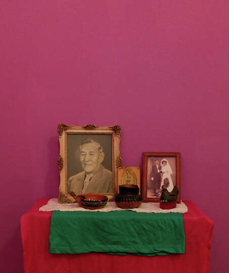 Portraits of individuals are seen on a altar at the Rinconcito de Esperanza house on Tuesday, Oct. 3