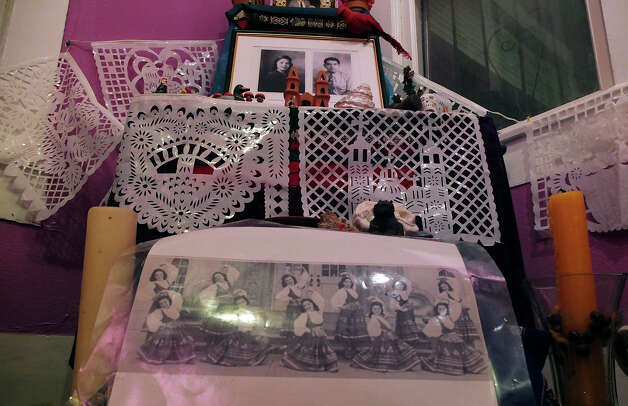 An altar is shown with various symbols and decorations to honor the deceased at the Rinconcito de Esperanza house on Tuesday, Oct. 30, 2012. About 20 altars were being put in the home which serves as a center for historical preservation for the Westside of San Antonio. A celebration for Dia de Los Muertos will be held at the home on Nov. 1 and will remain on display for 10 days thereafter. Photo: Kin Man Hui, San Antonio Express-News / ©2012 San Antonio Express-News