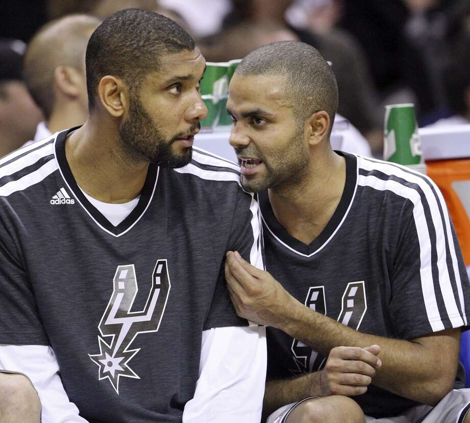 San Antonio Spurs' Tim Duncan and Tony Parker talk on the bench during second half action against the Oklahoma City Thunder Thursday Nov. 1, 2012 at the AT&T Center. The Spurs won 86-84. (Edward A. Ornelas / San Antonio Express-News)