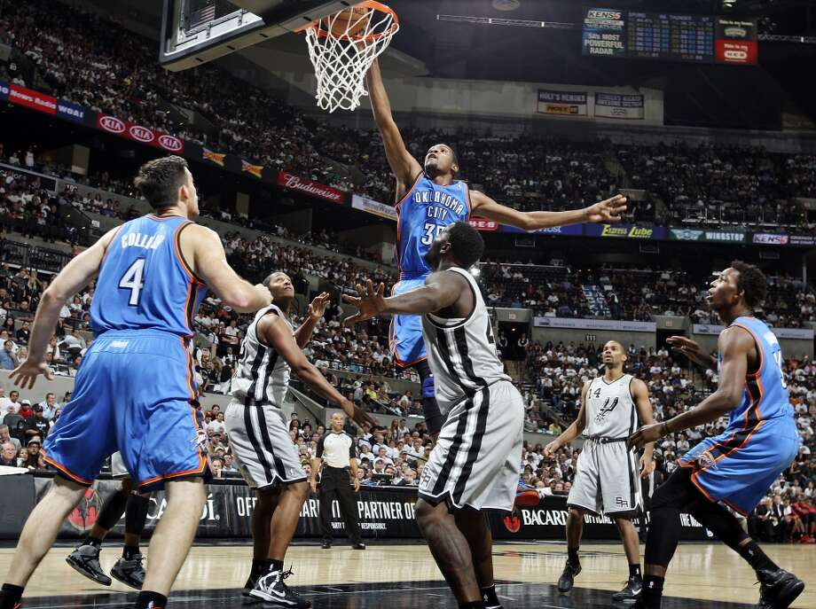 Oklahoma City Thunder's Kevin Durant dunks against the San Antonio Spurs  during second half action Thursday Nov. 1, 2012 at the AT&T Center. The Spurs won 86-84. (Edward A. Ornelas / San Antonio Express-News)