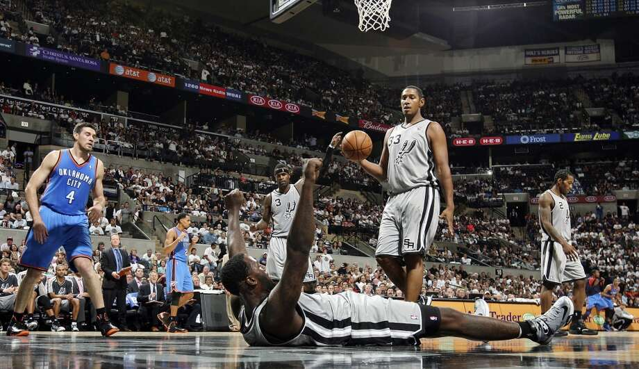San Antonio Spurs' DeJuan Blair reacts after Oklahoma City Thunder's Nick Collison (left) was called with a charging foul during second half action Thursday Nov. 1, 2012 at the AT&T Center. The Spurs won 86-84. (Edward A. Ornelas / San Antonio Express-News)
