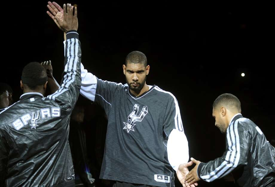 San Antonio Spurs veteran forward Tim Duncan looks determined as he is introduced before the Spurs' home opener against the Oklahoma City Thunder at the AT&T Center on Thursday, Nov. 1, 2012. (Billy Calzada / San Antonio Express-News)