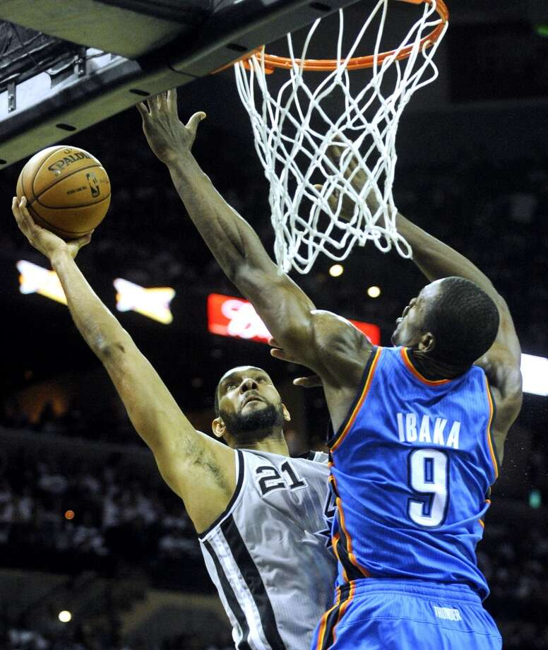 The Spurs' Tim Duncan hits a second-half shot over Serge Ibaka of Oklahoma City during NBA action at the AT&T Center on Thursday, Nov. 1, 2012. The game was the home opener for the Spurs. (Billy Calzada / San Antonio Express-News)