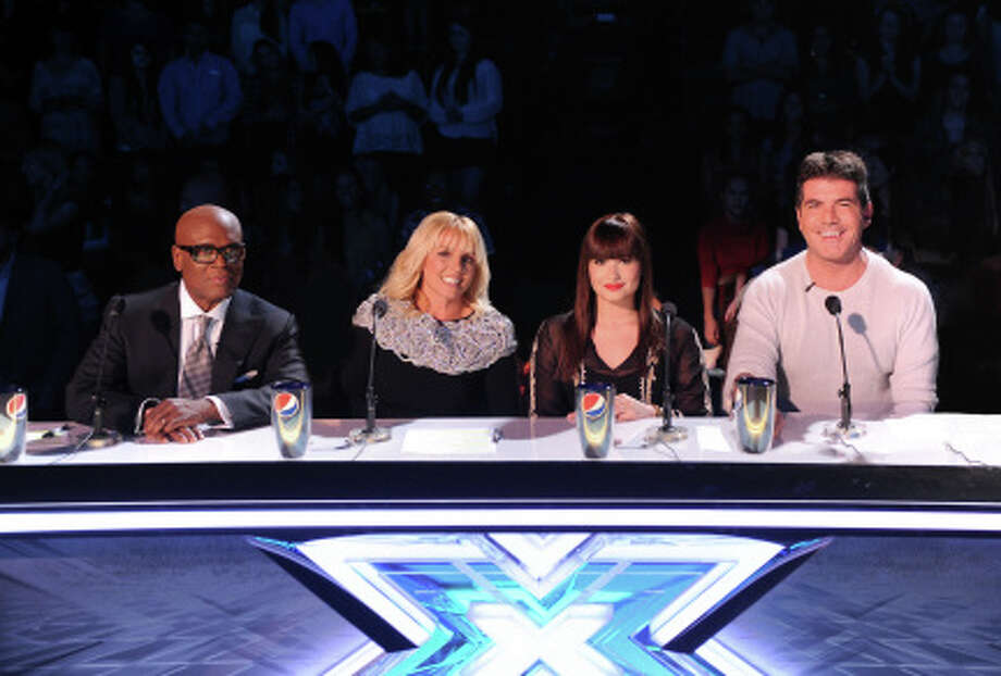 Judges L.A. Reid, Britney Spears, Demi Lovato and Simon Cowell live on THE X FACTOR. (                                                      )