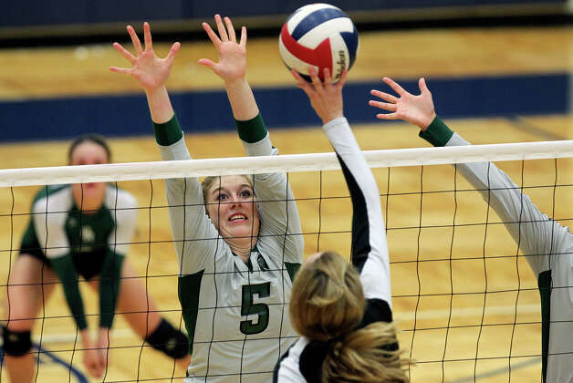 Alyssa Adams defends for the Rattlers as Reagan defeats Clark 3-0 in 5A second round volleyball playoff action at TAylor Field House on November 1, 2012. Photo: Tom Reel, Express-News / ©2012 San Antono Express-News