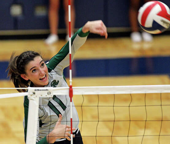 Rattler Ashlie Reasor jams a shot across from the right as Reagan defeats Clark 3-0 in 5A second round volleyball playoff action at TAylor Field House on November 1, 2012. Photo: Tom Reel, Express-News / ©2012 San Antono Express-News