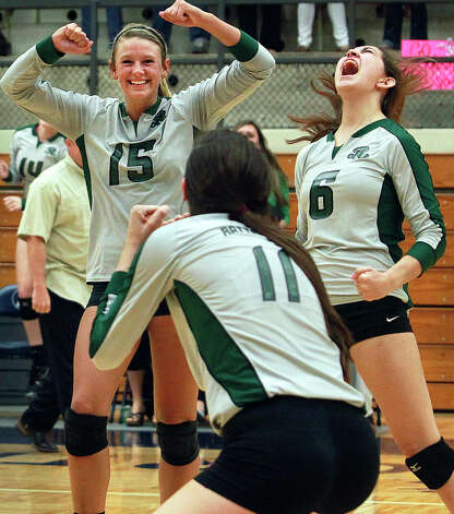 Rattler players Brooke Sassin (15), Ashlie Reasor (11) and Krista Kolbinskie  celebrate the final point as Reagan defeats Clark 3-0 in 5A second round volleyball playoff action at TAylor Field House on November 1, 2012. Photo: Tom Reel, Express-News / ©2012 San Antono Express-News