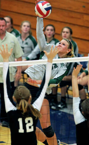 Brooke Sassin powers another kill shot as Reagan defeats Clark 3-0 in 5A second round volleyball playoff action at TAylor Field House on November 1, 2012. Photo: Tom Reel, Express-News / ©2012 San Antono Express-News