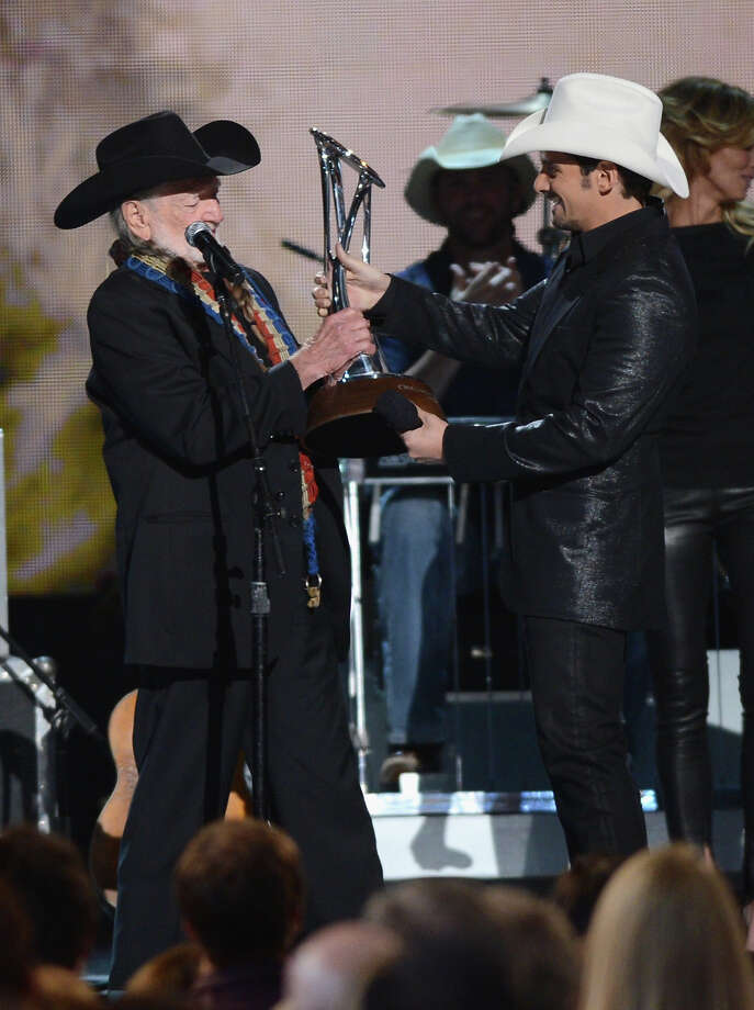 NASHVILLE, TN - NOVEMBER 01:  Willie Nelson (L) and Brad Paisley speak onstage during the 46th annual CMA Awards at the Bridgestone Arena on November 1, 2012 in Nashville, Tennessee. Photo: Jason Kempin, Getty Images / 2012 Getty Images