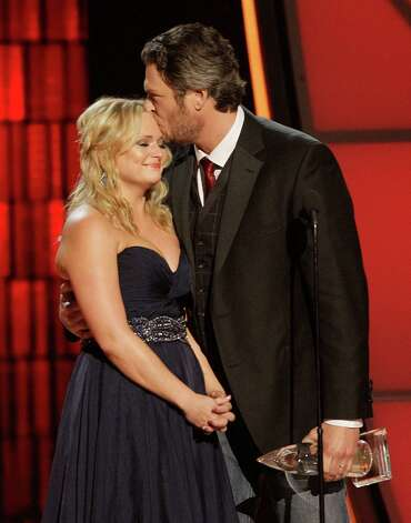 "Miranda Lambert, left, and Blake Shelton accept song of the year award for ""Over You"" at the 46th Annual Country Music Awards at the Bridgestone Arena on Thursday, Nov. 1, 2012, in Nashville, Tenn. Lambert got emotional as Shelton talked about the loss of his brother Richie and the song he wrote to honor him. (Photo by Wayde Payne/Invision/AP) Photo: Wayde Payne"