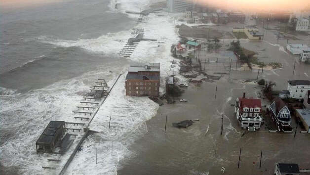 A reader says Hurricane Sandy should teach us a harsh  lesson: Barrier islands serve as barriers, not as population centers. Photo: Dann Cuellar, Associated Press / 6abc Action News/WPVI-TV