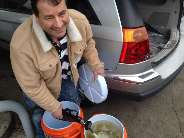 "Manhattan resident Gabor Kocsis fills up two Home Depot water containers at Gulf Express next to Exit 9 on East Main Street Friday morning. Kocsis said there was no gas at the stations he stopped at in the Bronx early on the morning Friday and he desperately needed fuel.  ""It's crazy, you know,"" Kocsis said of filling up the water containers with gasoline. ""Home Depot is out of canisters. I know this isn't right, but I can't do better"" Photo: Stamford Advocate"