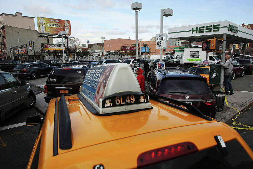 NEW YORK, NY - NOVEMBER 01:  People  wait in line for over two hours for gasoline as the city contin