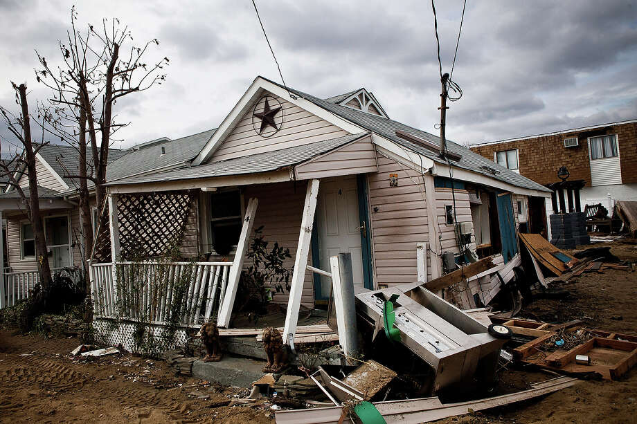 HIGHLANDS, NJ - NOVEMBER 01:  A destroyed home is seen on November 1, 2012 in Highlands, New Jersey. Superstorm Sandy, which has left millions without power or water, continues to affect business and daily life throughout much of the eastern seaboard. Photo: Andrew Burton, Getty Images / 2012 Getty Images