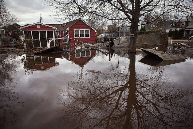 NEW YORK, NY - NOVEMBER 01:  Water continues to flood a neighborhood on November 1, 2012  in the Ocean Breeze area of the Staten Island borough of New York City. Most homes in the seaside community were inundated by the ocean surge caused by Superstorm Sandy. Photo: John Moore, Getty Images / 2012 Getty Images