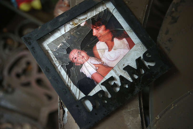 NEW YORK, NY - NOVEMBER 01:  Family photos lie in the debris of Michael Russo's flood damaged home o