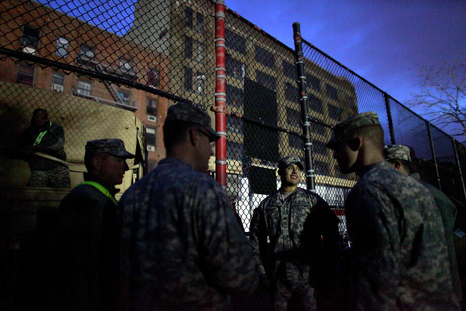 NEW YORK, NY - NOVEMBER 01: Members of the Army National Guard stand outside a distribution center November 1, 2012 in New York City. Limited public transit has returned to New York. With the death toll continuing to rise and millions of homes and businesses without power, the U.S. east coast is attempting to recover from the effects of floods, fires and power outages brought on by Superstorm Sandy. Photo: Allison Joyce, Getty Images / 2012 Getty Images