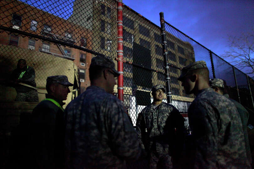 NEW YORK, NY - NOVEMBER 01: Members of the Army National Guard stand outside a distribution center N