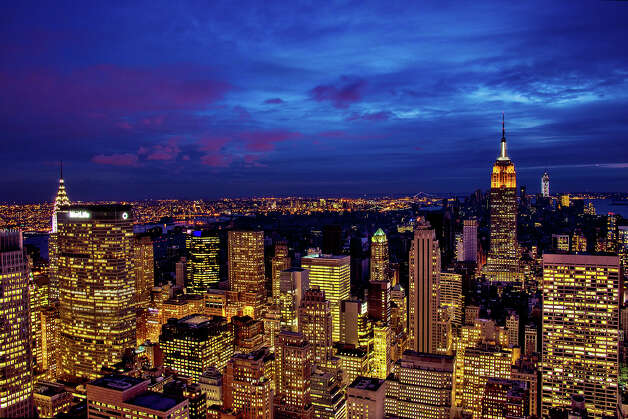 "NEW YORK, NY - NOVEMBER 01:  The midtown skyline remains lit as Lower Manhattan remains mostly without power on November 1, 2012 in New York City. The storm has claimed at least 16 lives in the United States, and has caused massive flooding across much of the Atlantic seaboard. U.S. President Barack Obama has declared the situation a ""major disaster"" for large areas of the U.S. east coast, including New York City. Photo: Afton Almaraz, Getty Images / 2012 Getty Images"