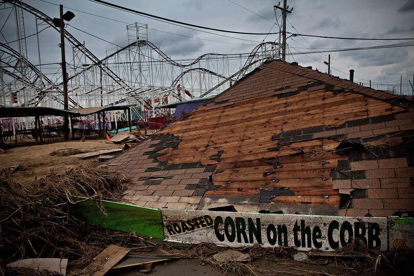 KEANSBURG, NJ - NOVEMBER 01:  Damaged rides and debris are strewn across Keansburg Amusement Park af
