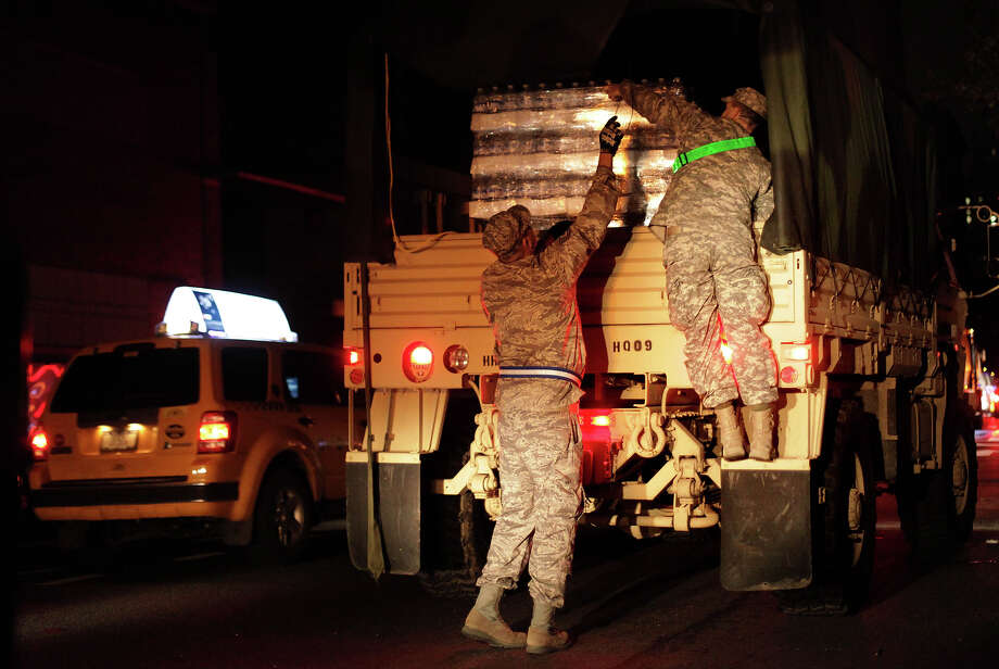 NEW YORK, NY - NOVEMBER 1: The National Guard unload water from a truck November 1, 2012 in New York City. Limited public transit has returned to New York. With the death toll continuing to rise and millions of homes and businesses without power, the U.S. east coast is attempting to recover from the effects of floods, fires and power outages brought on by Superstorm Sandy. Photo: Allison Joyce, Getty Images / 2012 Getty Images