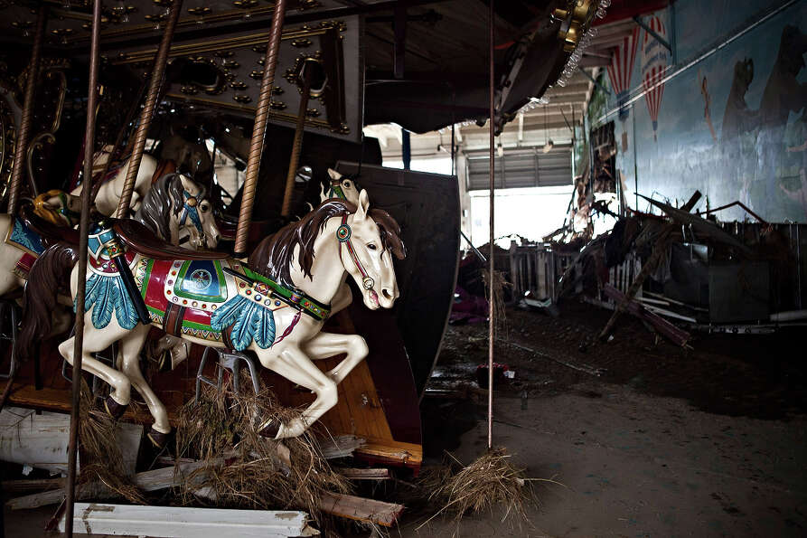 KEANSBURG, NJ - NOVEMBER 01: A heavily damaged carousel sits inside Keansburg Amusement Park after S