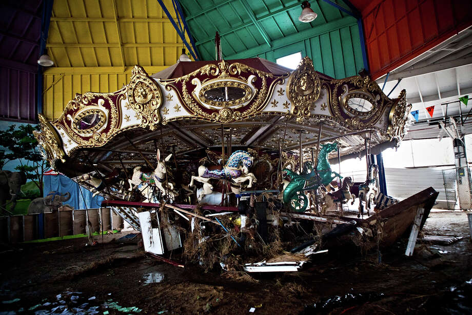 KEANSBURG, NJ - NOVEMBER 01: A heavily damaged carousel sits inside Keansburg Amusement Park after Superstorm Sandy swept across the region, on November 1, 2012 in Keansburg, New Jersey. Superstorm Sandy, which has left millions without power or water, continues to effect business and daily life throughout much of the eastern seaboard. Photo: Andrew Burton, Getty Images / 2012 Getty Images