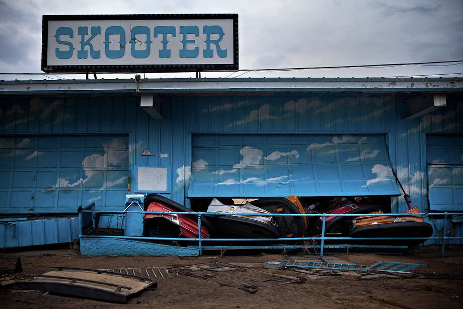 KEANSBURG, NJ - NOVEMBER 01: Damaged bumper cars poke through a garage door at the Keansburg Amusement Park after Superstorm Sandy swept across the region, on November 1, 2012 in Keansburg, New Jersey. Superstorm Sandy, which has left millions without power or water, continues to effect business and daily life throughout much of the eastern seaboard. Photo: Andrew Burton, Getty Images / 2012 Getty Images