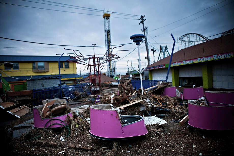 KEANSBURG, NJ - NOVEMBER 01: Damaged rides and debris are strewn across the Keansburg Amusement Park after Superstorm Sandy swept across the region, on November 1, 2012 in Keansburg, New Jersey. Superstorm Sandy, which has left millions without power or water, continues to effect business and daily life throughout much of the eastern seaboard. Photo: Andrew Burton, Getty Images / 2012 Getty Images
