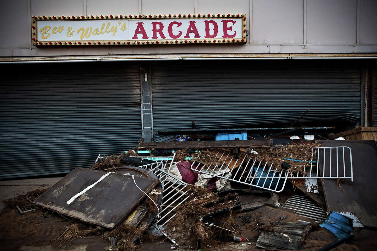KEANSBURG, NJ - NOVEMBER 01: Debris is piled up in front of the arcade at the heavily damaged Keansburg Amusement Park after Superstorm Sandy swept across the region, on November 1, 2012 in Keansburg, New Jersey. Superstorm Sandy, which has left millions without power or water, continues to effect business and daily life throughout much of the eastern seaboard.
