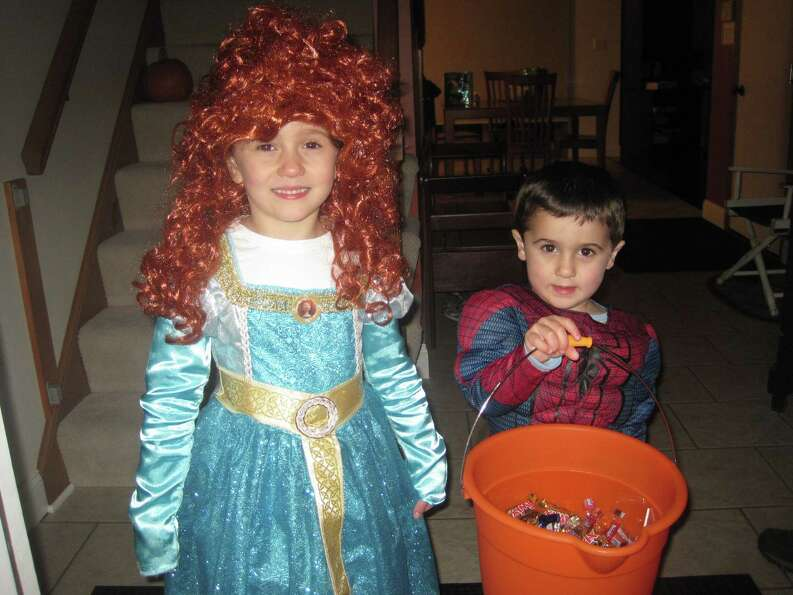 Abigail and Daniel Hughes dress up as a princess and a super hero. Photo by Rosa D'Ambrosio/New Vi