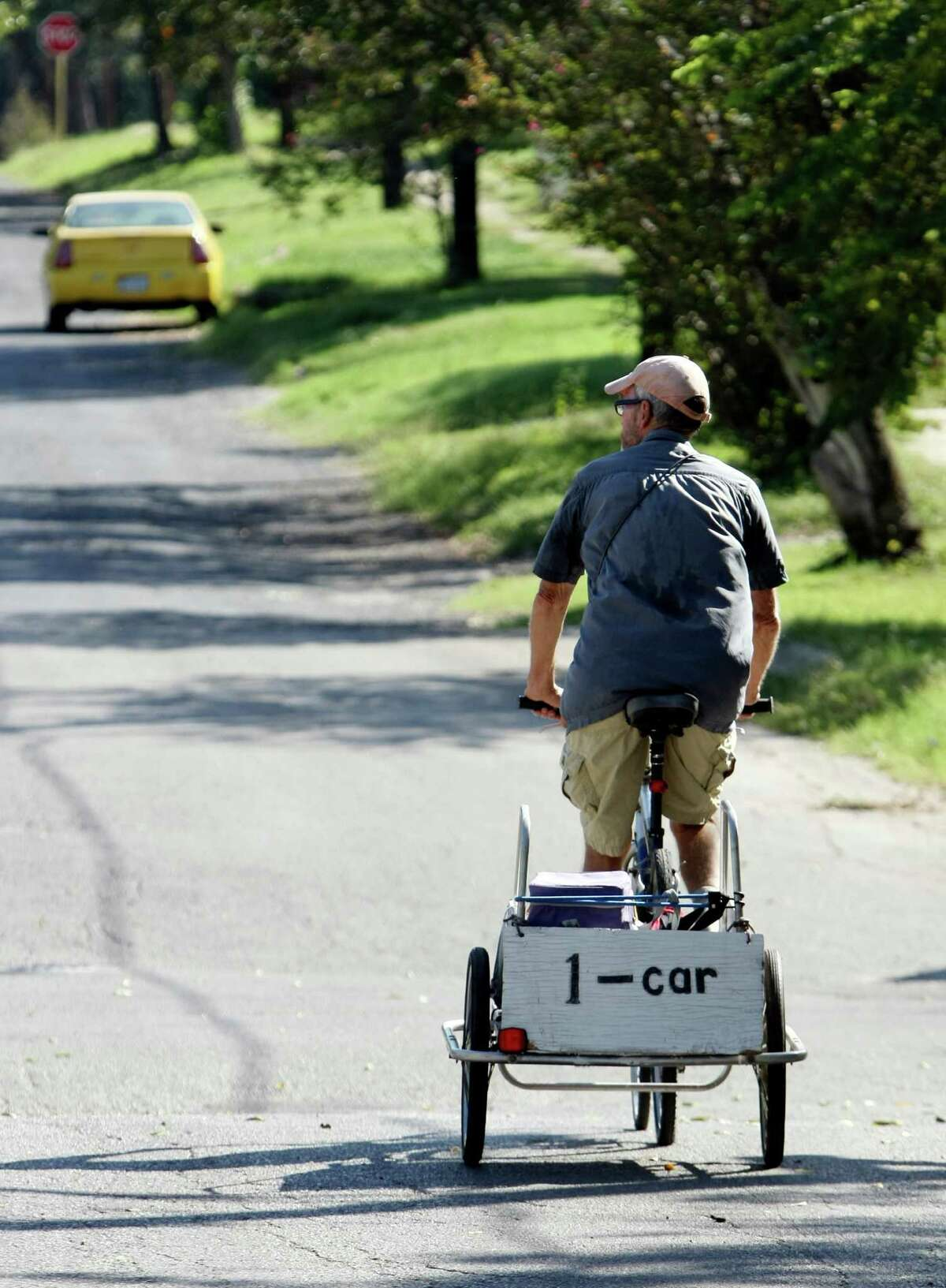 One less car on the road is the message on Jack Elder's bicycle trailer, which he rides around the East Side delivering lunches to elderly San Antonians.