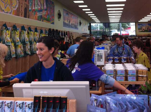 Jessica Bargo rings up a customer at the newly opened Trader Joe's at Alamo Quarry Village Friday morning. Bargo normally works at the chain's Fort Worth store, but she was working at the San Antonio location on opening day. Photo: Ana Ley/Express-News