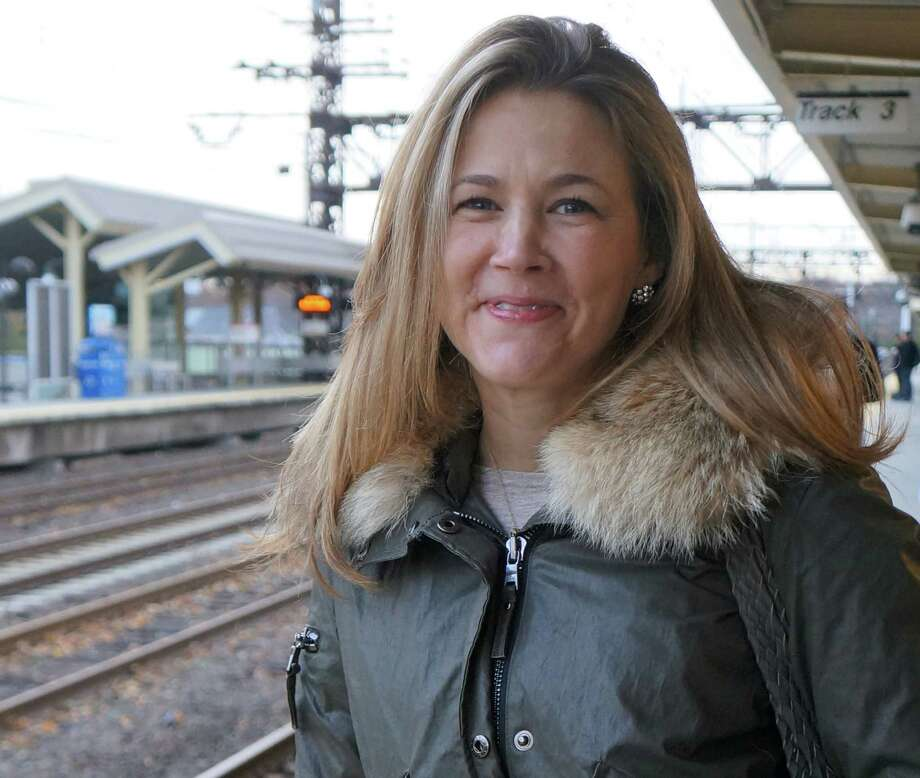 Dina Singer, who works at InStyle magazine in Manhattan, was among the Friday morning commuters from Westport who returned to riding Metro-North Railroad when service was restored after a four-day suspension because of Hurricane Sandy. Photo: Paul Schott / Westport News