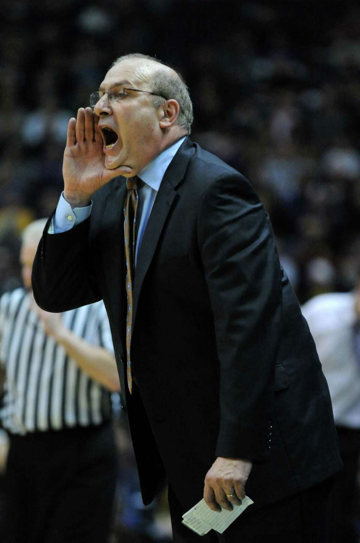 Siena men's basketball coach Mitch Buonaguro calls out instructions to his team during the second half of their 64-60 win over UAlbany at the Times Union Center on Monday night Dec. 5, 2011 in Albany, NY. (Philip Kamrass / Times Union )