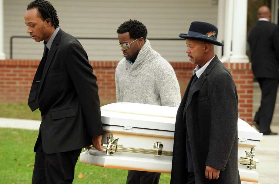 Amari Welburn's father Derek Welburn leads pallbearers Jeffrey White and Clifton Smith as they carry his daughters casket from the Metropolitan Baptist Church following the 3-year-olds funeral service in Albany, NY Friday Nov. 2, 2012. (Michael P. Farrell/Times Union) Photo: Michael P. Farrell