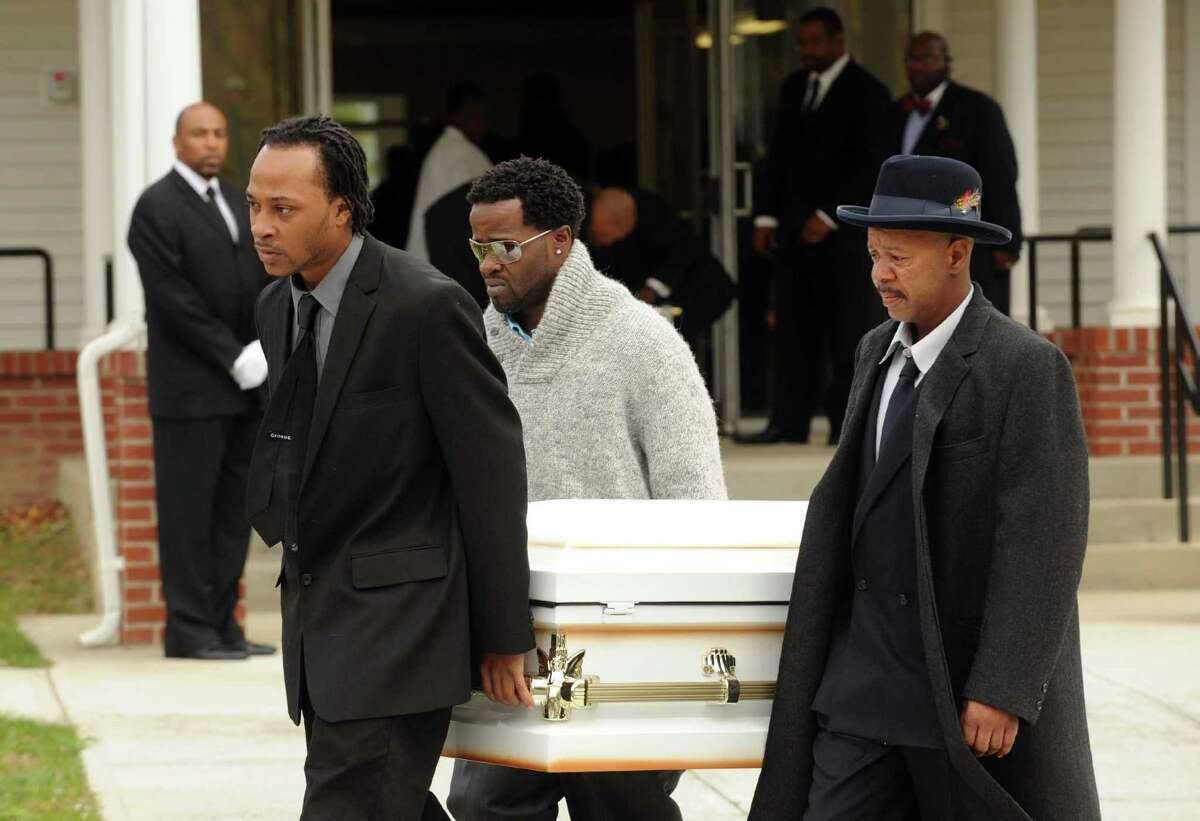 Amari Welburn's father Derek Welburn leads pallbearers Jeffrey White and Clifton Smith as they carry his daughters casket from the Metropolitan Baptist Church following the 3-year-olds funeral service in Albany, NY Friday Nov. 2, 2012. (Michael P. Farrell/Times Union)