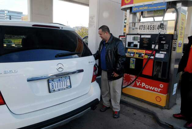 Robert Lourenzo from the Bronx, New York fills up at the Gulf gas station on West Broad St in Stamford, Conn. on Friday November 2, 2012. Photo: Dru Nadler / Stamford Advocate Freelance