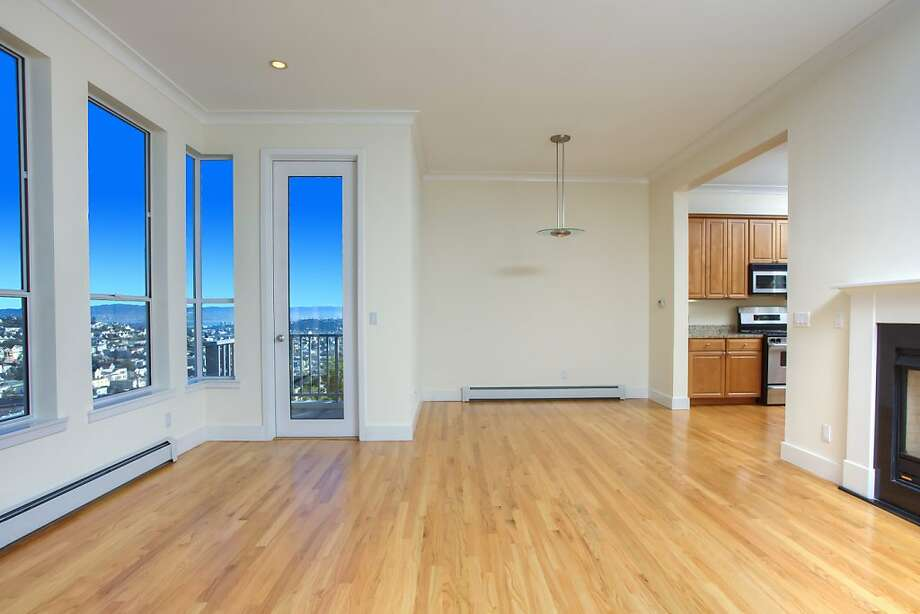 The great room has large windows and has access to the second-floor balcony. Photo: Mike McClellan