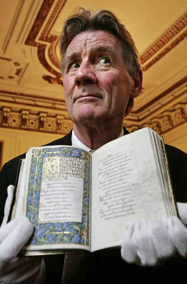 """Oxford graduate? Who knew? Former Monty Python actor and Oxford University graduate Michael Palin holds """"Odes of Horace"""" (1874) by author William Morris, as he attends the launch of the """"Oxford Thinking"""" campaign at the British Academy in London, on May 28, 2008. AFP PHOTO/Leon Neal Photo: LEON NEAL, Getty / 2008 AFP"""