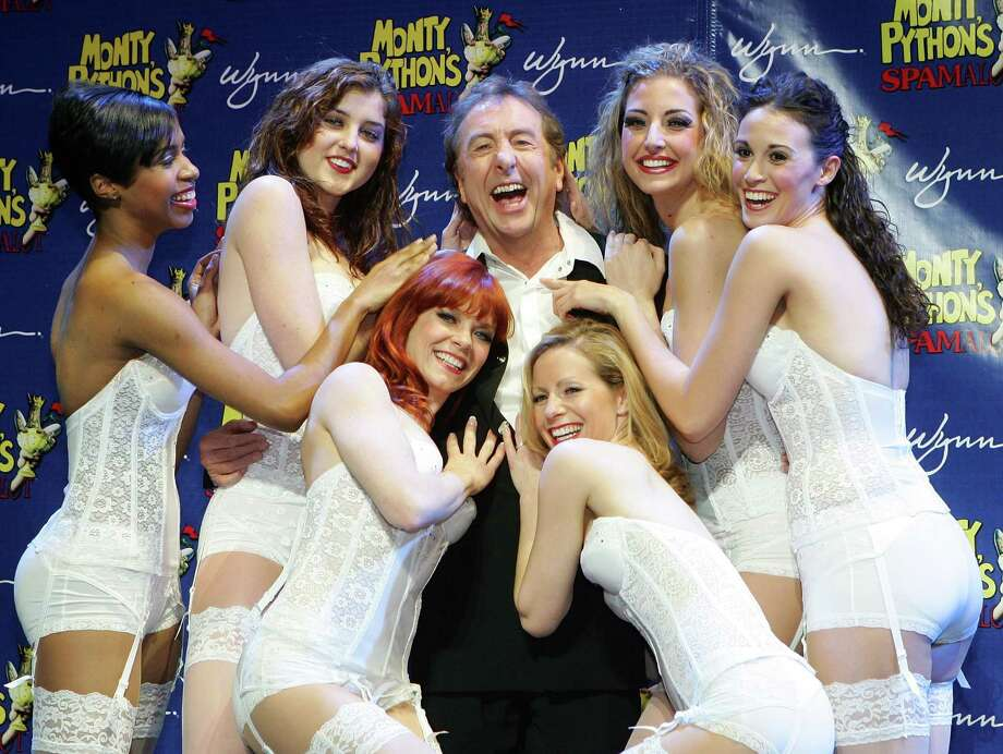 "Span hit the road, too. Actor/writer Eric Idle poses with dancers during a launch event to introduce ""Monty Python's Spamalot"" at The Grail Theater at the Wynn Las Vegas Jan. 22, 2007.  Photo: Ethan Miller, Getty / 2007 Getty Images"