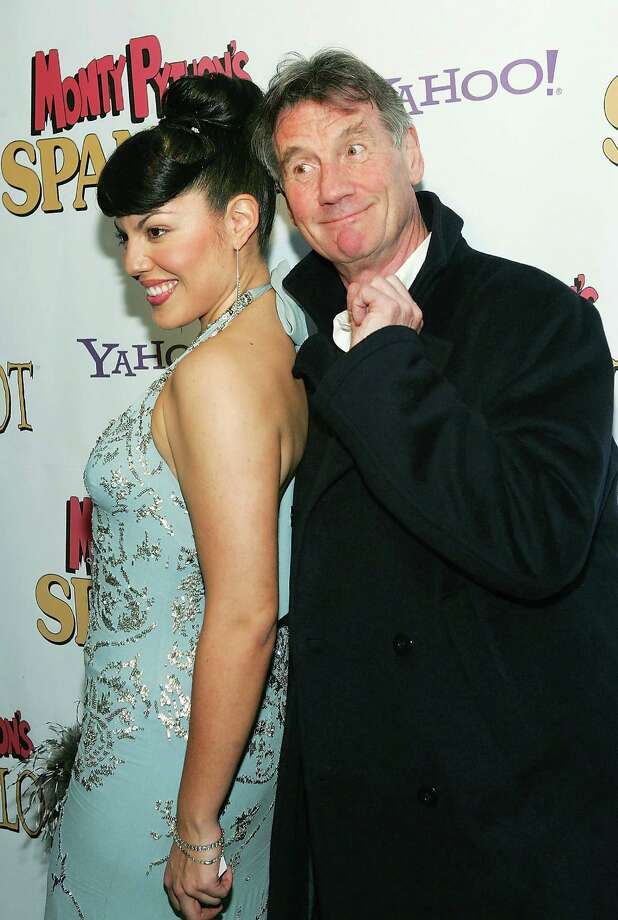 """Then there was the party.  Actress Sara Ramirez and actor Michael Palin attend the opening night after party for """"Monty Python's Spamalot"""" at Roseland Ballroom March 17, 2005, in New York City. Photo: Evan Agostini, Getty / 2005 Getty Images"""